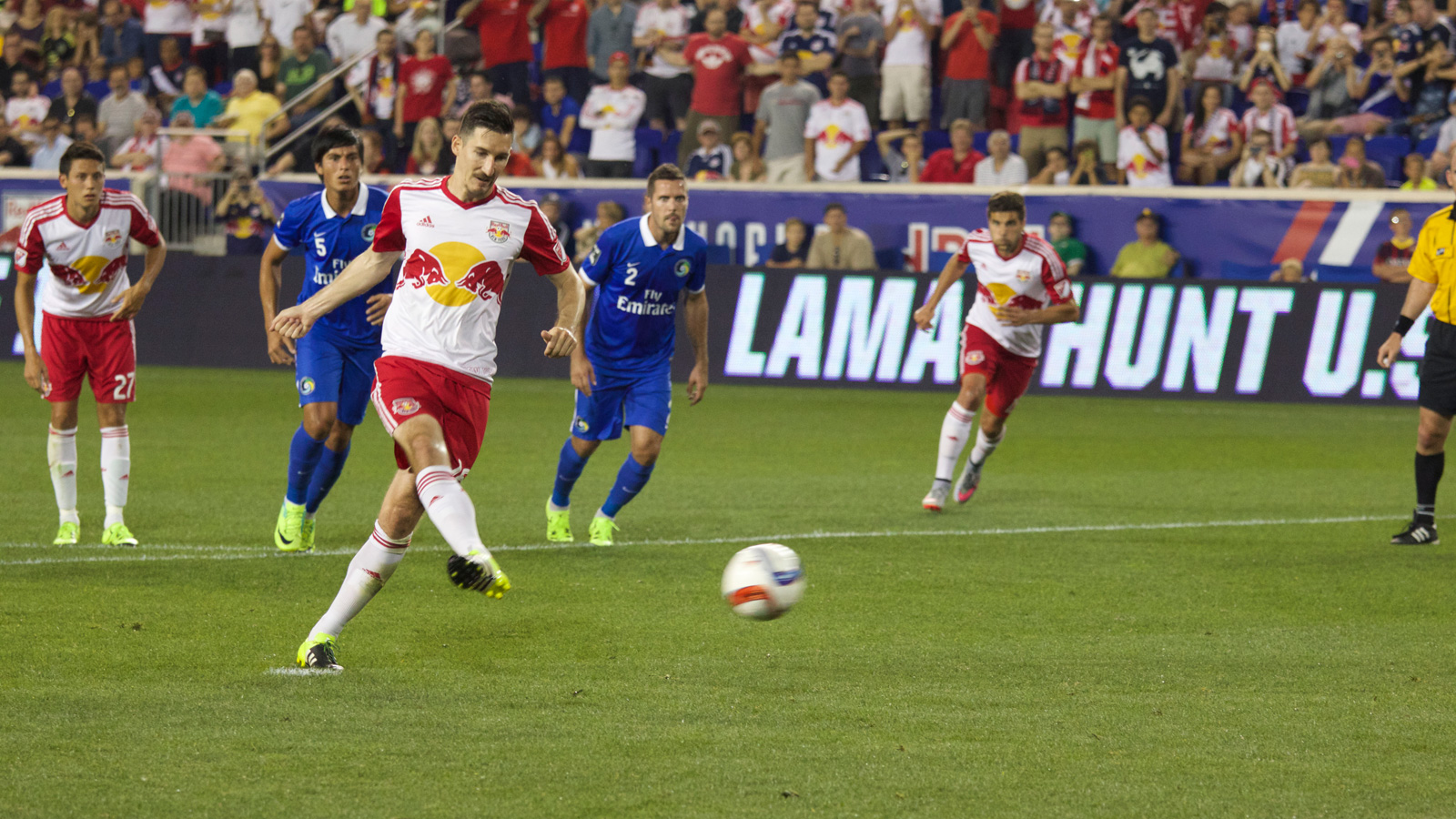 New York Red Bulls midfielder Sacha Kljestan (16) takes and makes the penalty kick, giving his side a 3-1 advantage over the Cosmos in the 54th minute of their 2015 U.S. Open Cup fifth-round match.