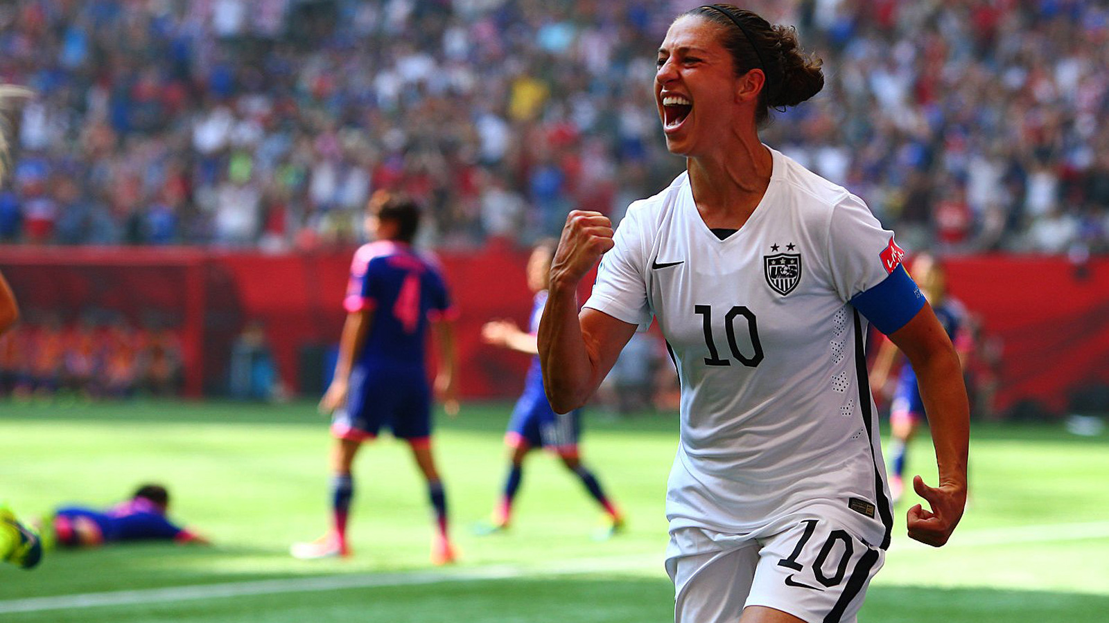 02e79ea738c Carli Lloyd celebrates one of her three goals for the USA vs. Japan in the