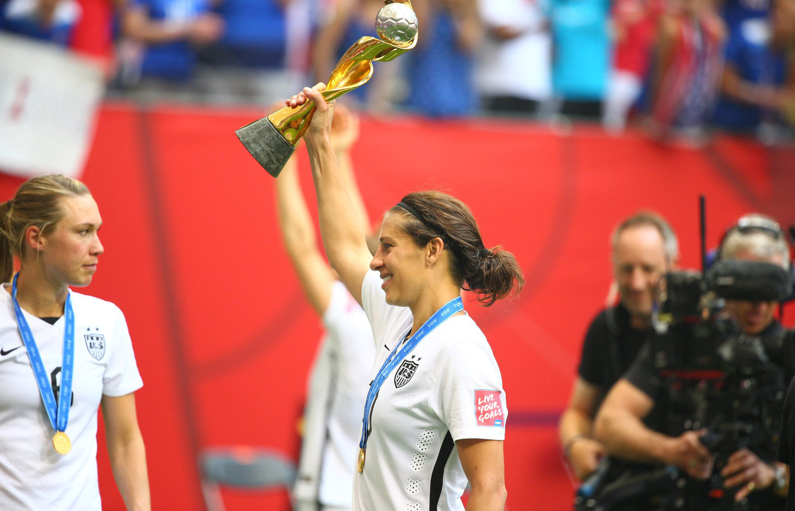 Carli Lloyd lifts the World Cup trophy after leading the USA to a 5-2 win over Japan in the final