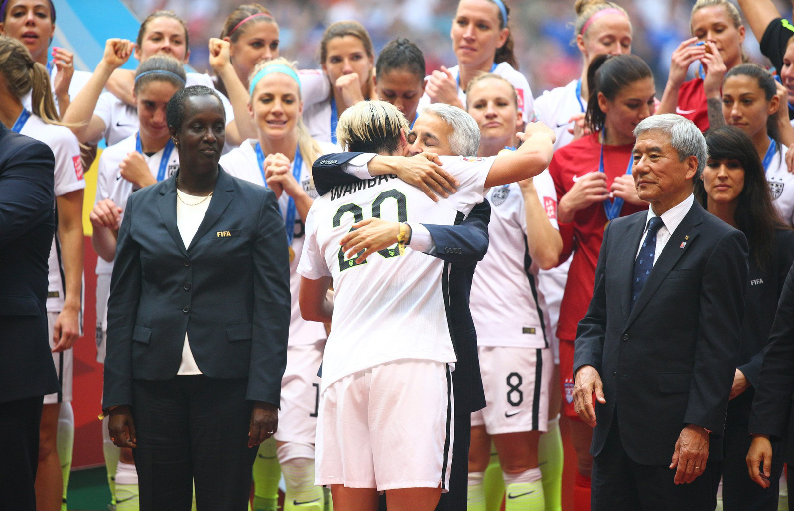 Abby Wambach hugs U.S. Soccer president Sunil Gulati on the winner's podium after capturing the Women's World Cup title