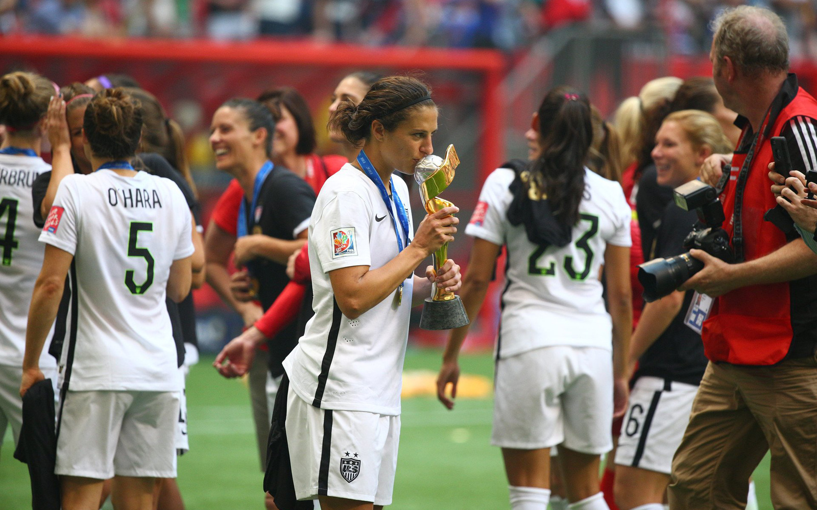 Carli Lloyd kisses the World Cup trophy after the USA's 5-2 win over Japan in the final