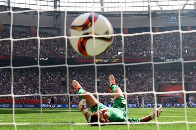 Japan goalkeeper Ayumi Kaihori tumbles to the ground as Carli Lloyd's shot from the center circle beats her and gives the USA a 4-0 lead in the Women's World Cup final