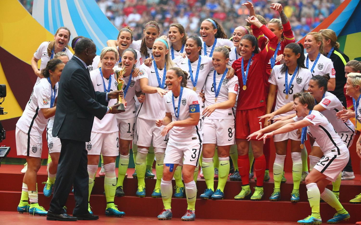 U.S. players feel the anticipation as captain Christie Rampone is about to be presented with the Women's World Cup trophy.
