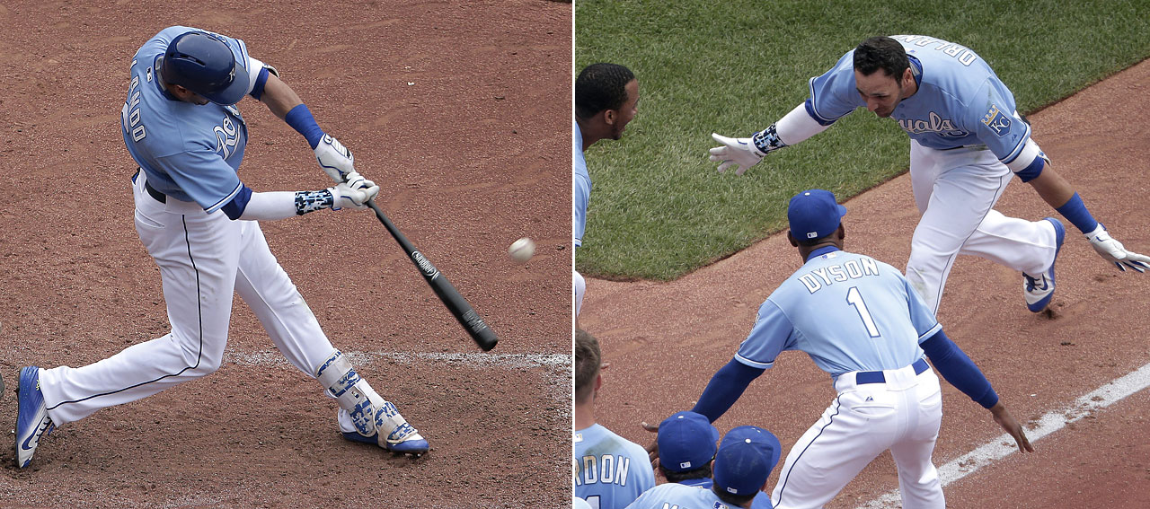 Kansas City Royals' Paulo Orlando hits a walk-off grand slam during the ninth inning of the first game in a baseball doubleheader against the Tampa Bay Rays Tuesday, July 7, 2015, in Kansas City, Mo. The Royals won 9-5.