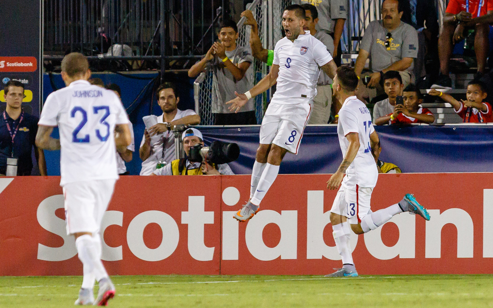 Clint Dempsey leaps in celebration of his second goal in the USA's Gold Cup opener against Honduras. The Americans won 2-1, fending off a late Honduras surge to collect all three points in the start of their title defense.