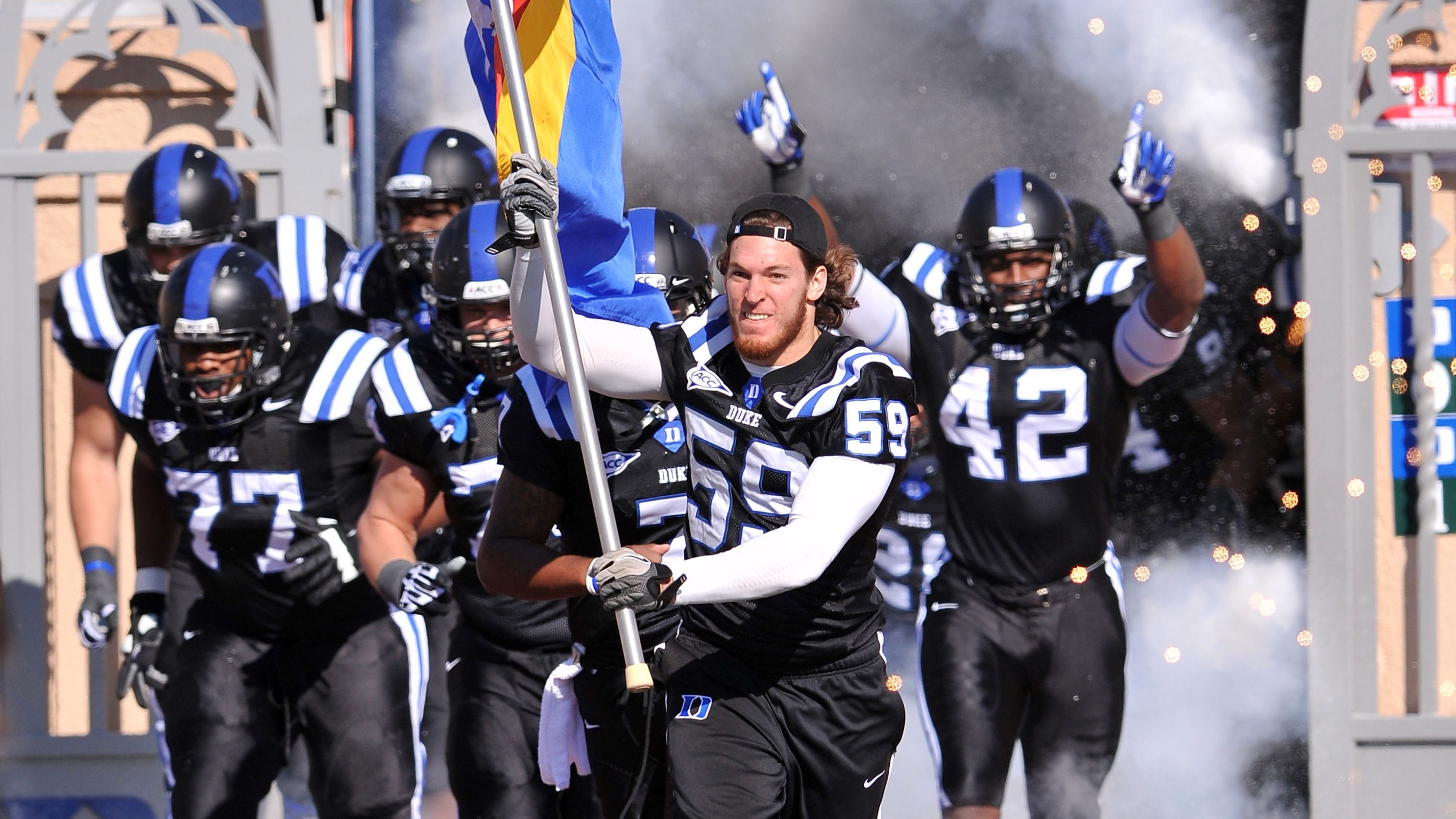 Kelby Brown (No. 59) tore his ACL for the second time in two years.