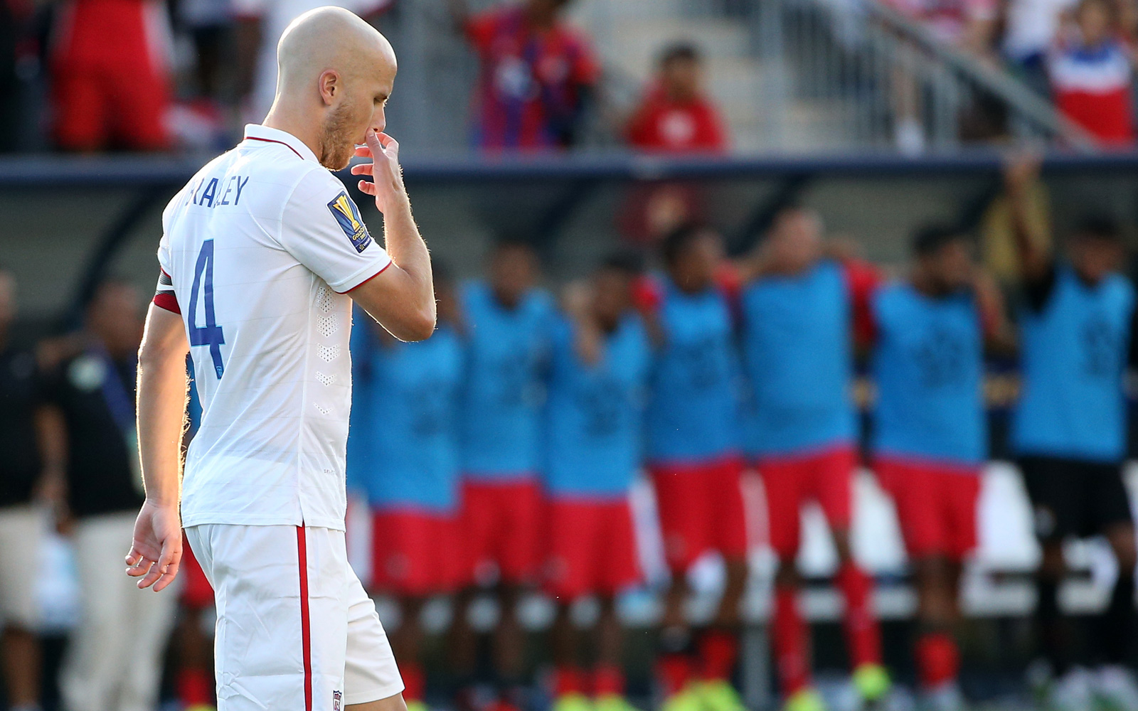 Michael Bradley walks away in dismay after having a penalty saved in a PK shootout in the USA's loss to Panama in the Gold Cup third-place game. After a 1-1 draw, Panama prevailed 3-2 in PKs, the USA's first shootout in 10 years.