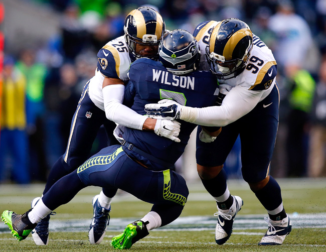 While he's yet to miss a game, Seattle's offense puts Wilson at greater risk than the average quarterback. (Jonathan Ferrey/Getty Images)