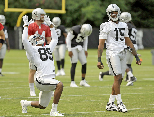 Amari Cooper and Michael Crabtree warm up at Raiders training camp