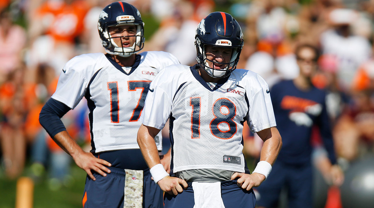 Peyton Manning and Brock Osweiler (Photo by David Zalubowski/AP)