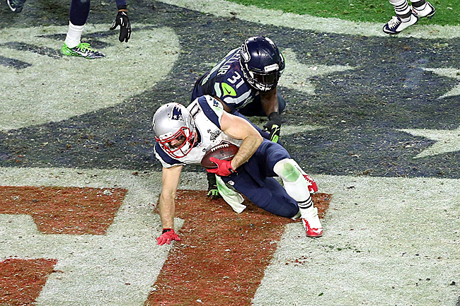 With medical timeouts coming into effect this season, Edelman likely could have been examined after sustaining this hit from Kam Chancellor in the Super Bowl. (Chris Coduto/Icon Sportswire)