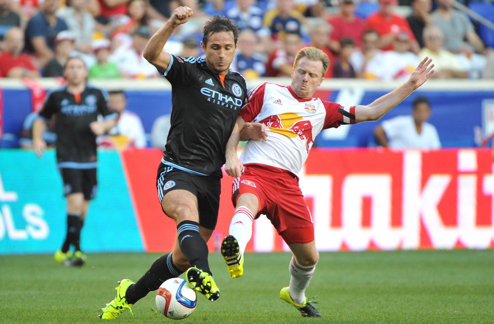 Frank Lampard and Dax McCarty battle for the ball at midfield. McCarty's Red Bulls came out on top again, completing the season sweep with an Aug. 9 2-0 win.