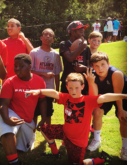 FLOWERY BRANCH, GA. — A group of young Falcons fans represent their team at Falcons camp.