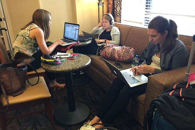 ANDERSON, IND. — Kalyn Kahler, Emily Kaplan and Jenny Vrentas found a few minutes to get some writing done in the lobby of the Hampton Inn Anderson before Colts practice.