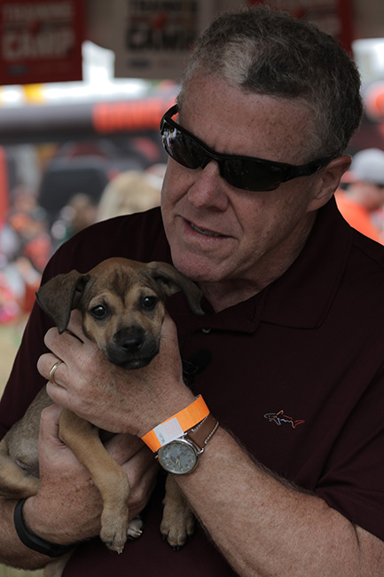 BEREA, OHIO — The Northeast Ohio SPCA set up crates and a makeshift adoption shelter on the sideline of the Browns' practice facility and dog-lover Peter quickly befriended a puppy.