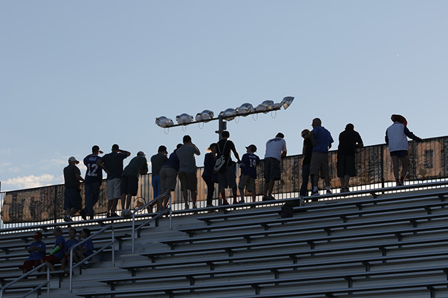 PITTSFORD, N.Y. — Bills fans looked out over the bleachers of Growney Stadium at St. John Fisher College before an evening practice.
