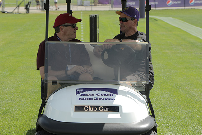 MANKATO, MINN. — Peter King took a ride in head coach Mike Zimmer's personalized golf cart after practice.