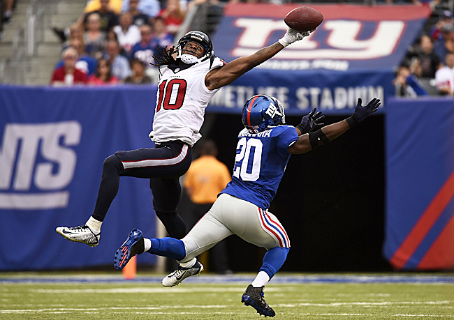 DeAndre Hopkins' 49-yard catch (yes, he held on) against the Giants last September was the catch of the year until Odell Beckham came along. (Alex Goodlett/Getty Images)