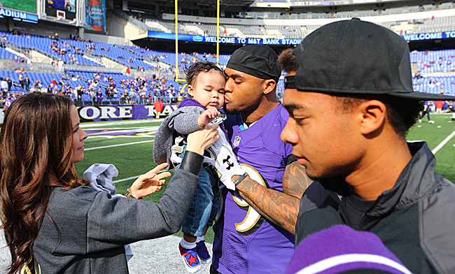 Steve Smith Sr. visits Steve Smith Jr. on the sideline.