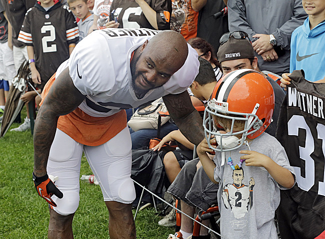 Homecoming: Donte Whitner, at 2014 training camp, returned to the hometown Browns last season. (Mark Duncan/AP)