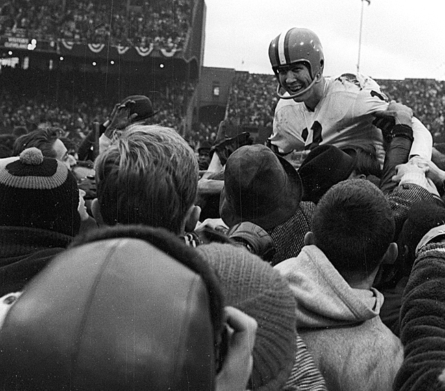 Quarterback Frank Ryan was carried off by fans after leading the Browns to victory in the 1964 NFL title game. It was the city's last championship. (James Drake/Sports Illustrated)