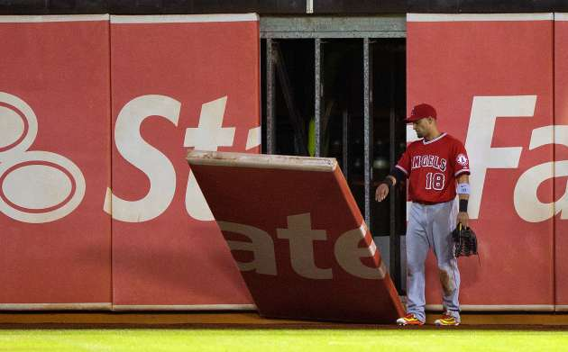 Angels Shane Victorino breaks outfield wall