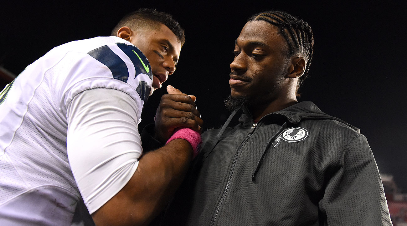 RG3 and Russell Wilson (Patrick Smith/Getty Images)
