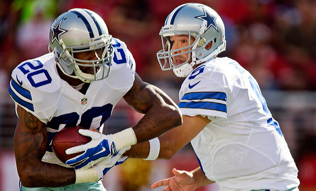 Dallas Cowboys quarterback Tony Romo hands the ball off to Darren McFadden in a recent preseason tilt. (Brian Bahr/Getty Images)