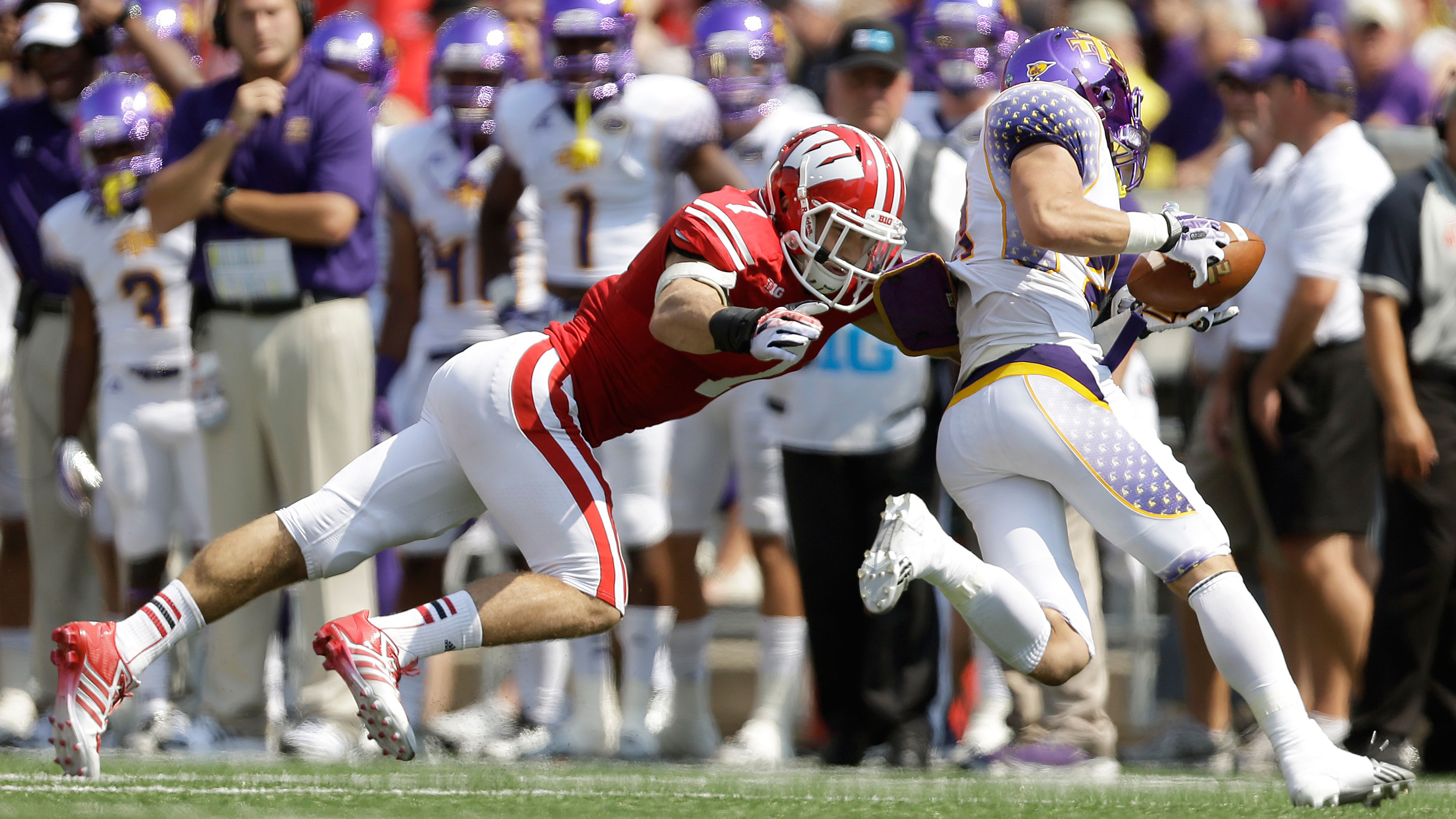 Wisconsin's Mike Caputo makes a tackle against Tennessee Tech in 2013.