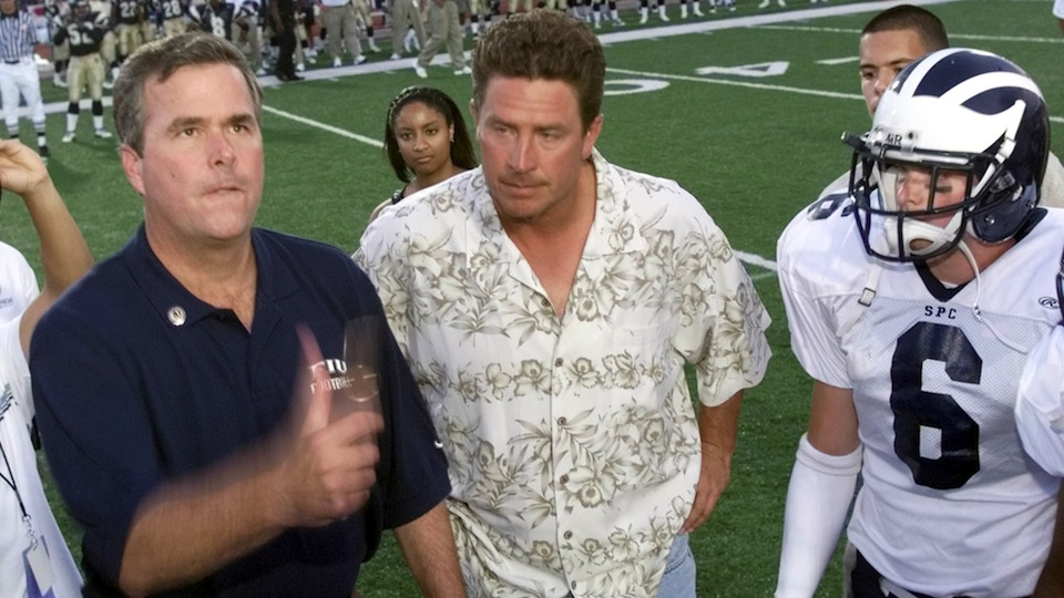 Jeb Bush, during his tenure as Florida's governor, with Dan Marino at the coin toss of a college football game.