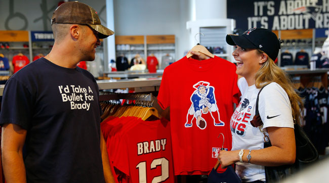 Patriots fans wear their hearts on their sleeves—or T's—as the season is set to start. (Photo: Jessica Rinaldi/The Boston Globe via Getty Images)