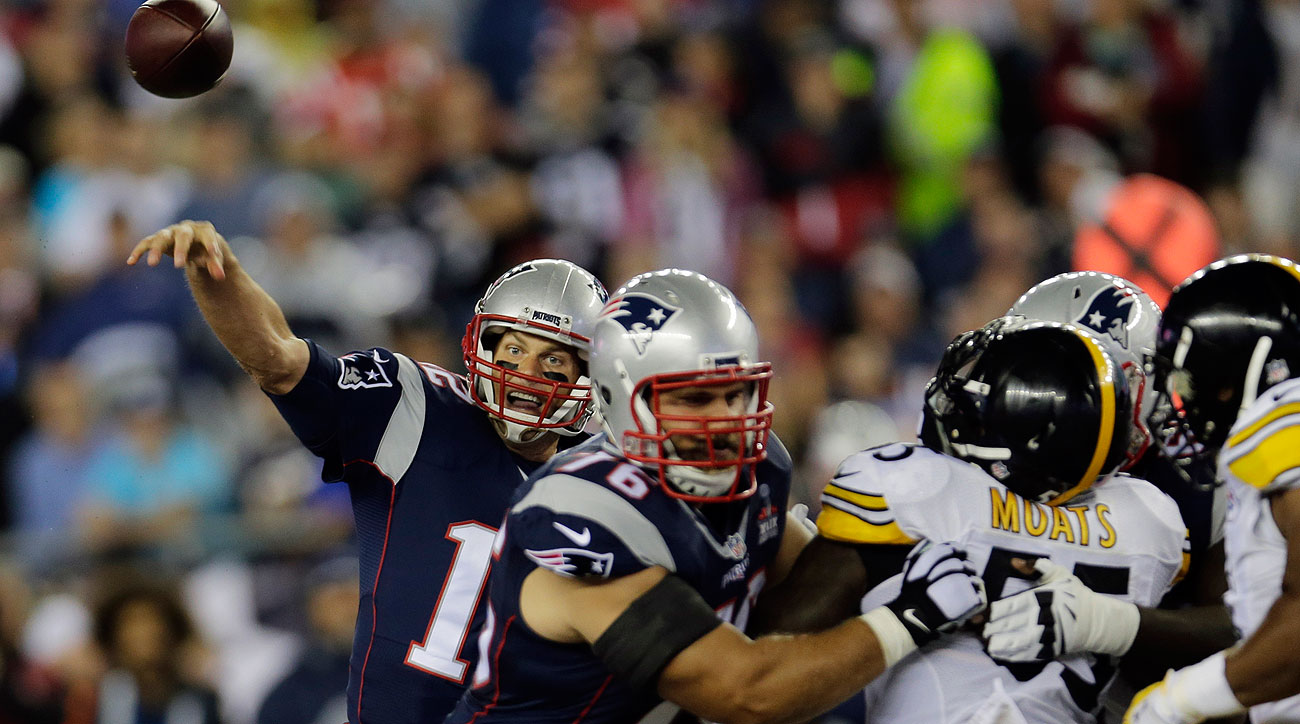 A rebuilt offensive line helped keep Brady clean most of the night. (Charles Krupa/AP)