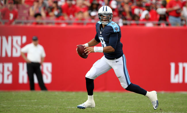 Marcus Mariota scans the field for a receiver in the Titans' season-opening win over the Buccaneers. (Gary Bogdon for Sports Illustrated/The MMQB)