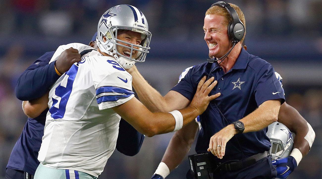 Tony Romo and Jason Garrett (Tom Pennington/Getty Images)
