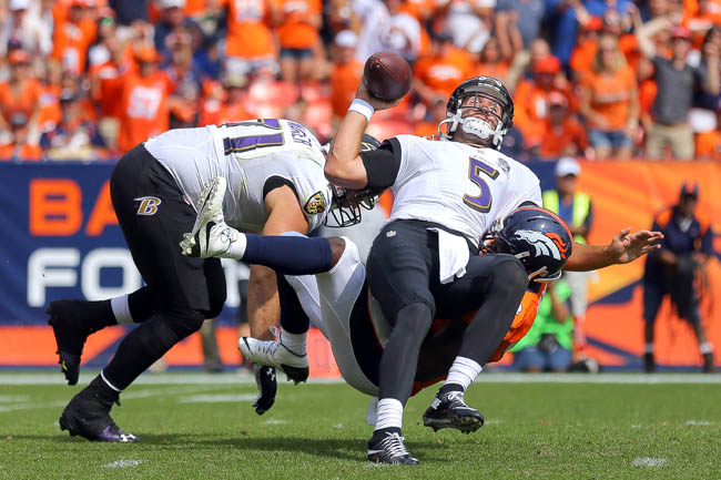 DeMarcus Ware and the Denver pass rush ruined Joe Flacco in the season opener. (Justin Edmonds/Getty Images)