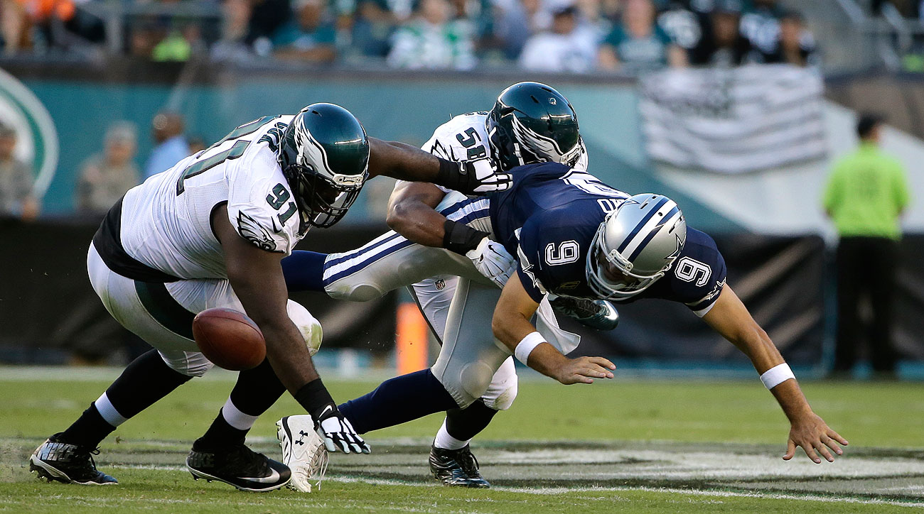 Tony Romo's clavicle was broken on this hit by Philadelphia's Jordan Hicks. (Matt Rourke/AP)