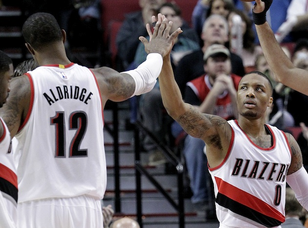 With LaMarcus Aldridge (l) off to San Antonio, can Damian Lillard be the face of the Blazers?