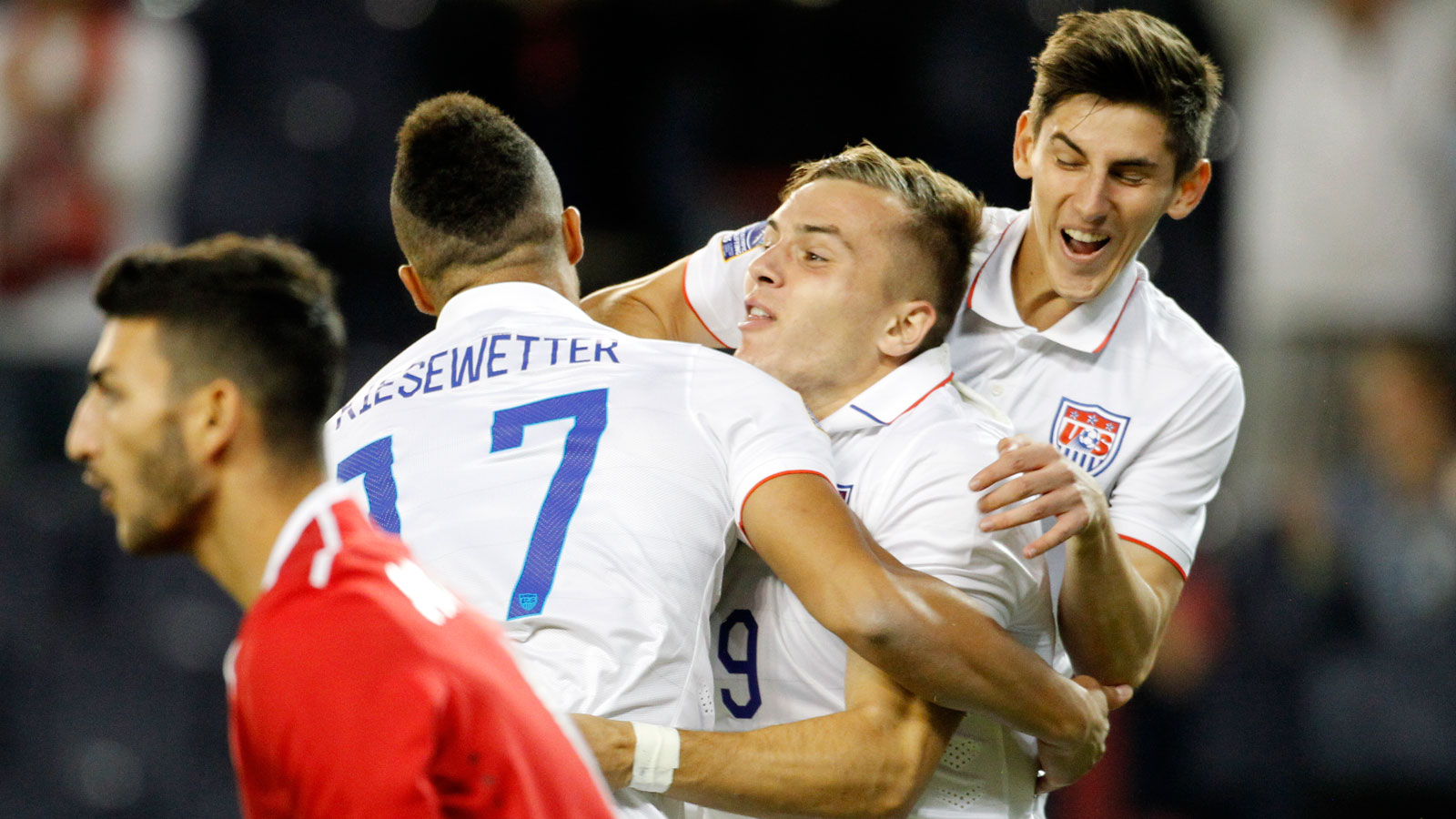 Jerome Kiesewetter, left, and Emerson Hyndman, right, sandwich Jordan Morris after his first-minute goal in the USA's 3-1 win over Canada in their Olympic qualifying opener.
