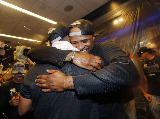 CC Sabathia and the New York Yankees celebrate in the locker room after beating the Boston Red Sox to secure a postseason berth.