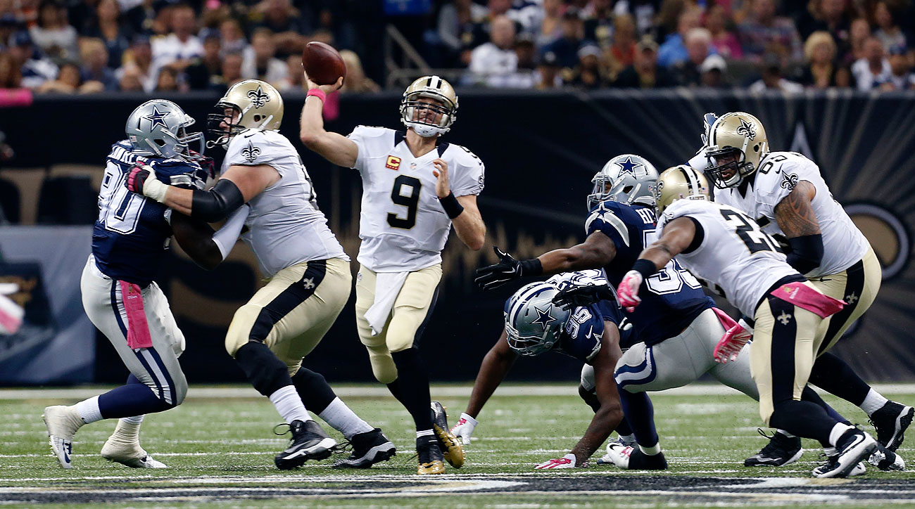 Drew Brees reached 400 touchdowns in his 205th NFL game, making him the fastest QB to hit that mark. (Jonathan Bachman/AP)