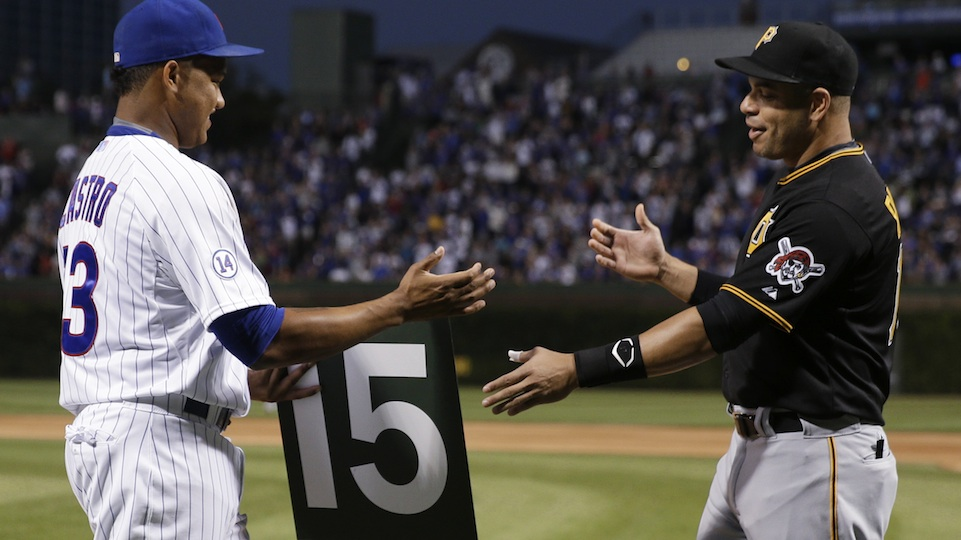 The Chicago Cubs' Starlin Castro (l) hands the No. 15 from the Wrigley field scoreboard to former Cub and current Pittsburgh Pirate Aramis Ramirez (r).