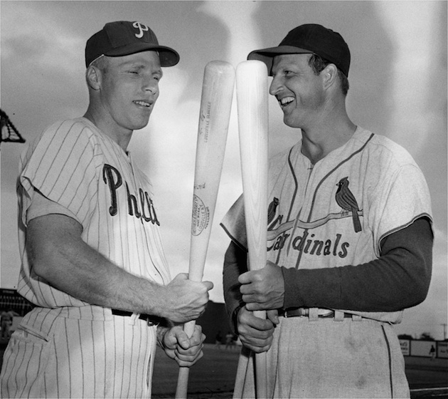 Richie Ashburn, pictured here with Stan Musial in 1955, was known to sleep with his bat.