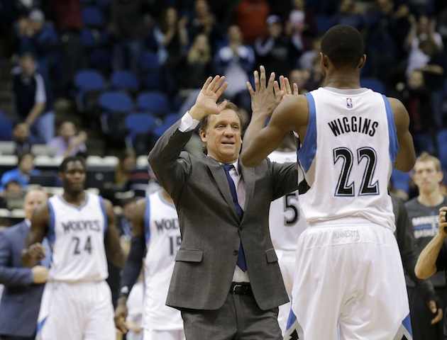 Flip Saunders congratulates Minnesota Timberwolves rookie forward Andrew Wiggins during the 2014-15 season.