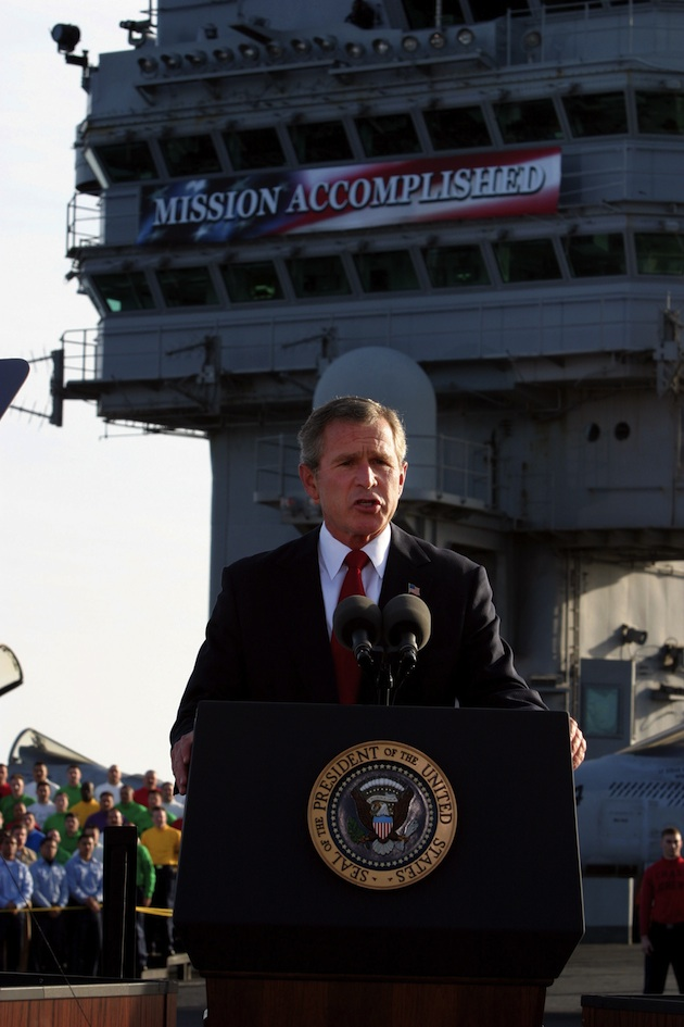 "George Bush on board the USS Abraham Lincoln is his now infamous ""Mission Accomplished"" photo."