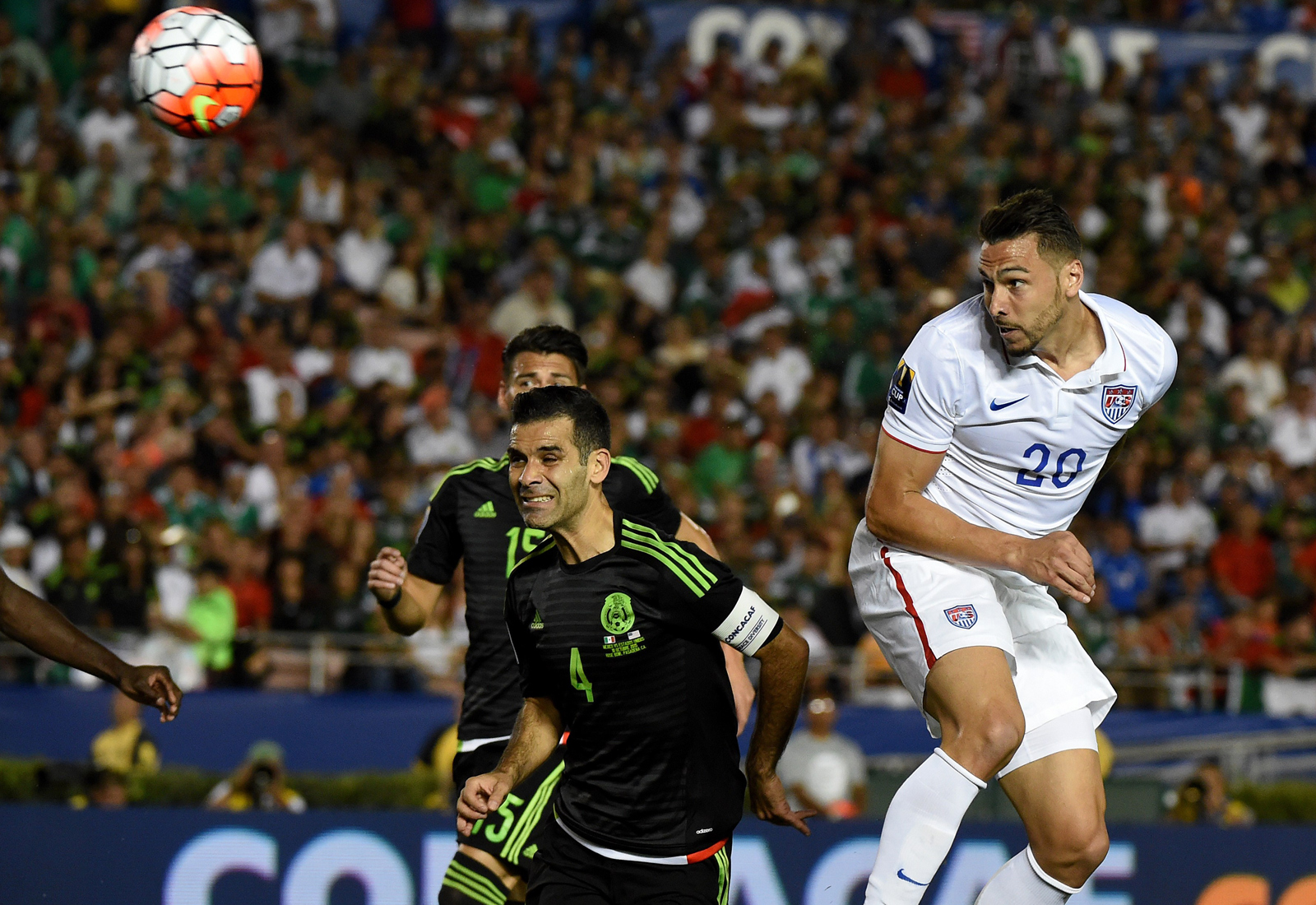 Geoff Cameron beats Rafa Marquez to the spot and heads home a 15th-minute equalizer off a free kick from Michael Bradley, negating a Chicharito goal five minutes earlier in the CONCACAF Cup playoff between USA and Mexico.