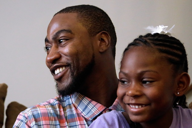 Adrian Arrington with his daughter in 2015.