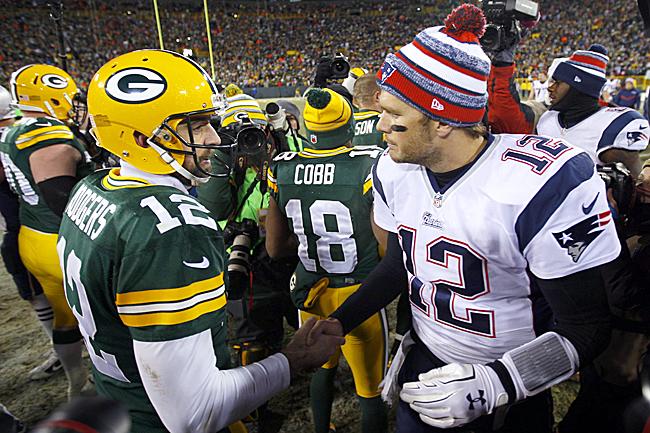 Aaron Rodgers and Tom Brady handshake.