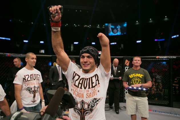 Nick Newell celebrates a MMA victory in 2013.