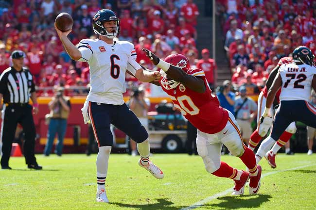 Chicago Bears quarterback Jay Cutler avoids Justin Houston's sack attempt last Sunday.