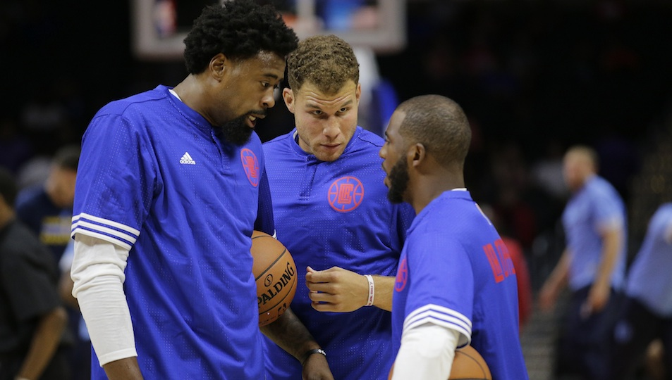 From left to right: DeAndre Jordan, Blake Griffin and Chris Paul huddle up during a Los Angeles Clippers preseason game in October, 2015.